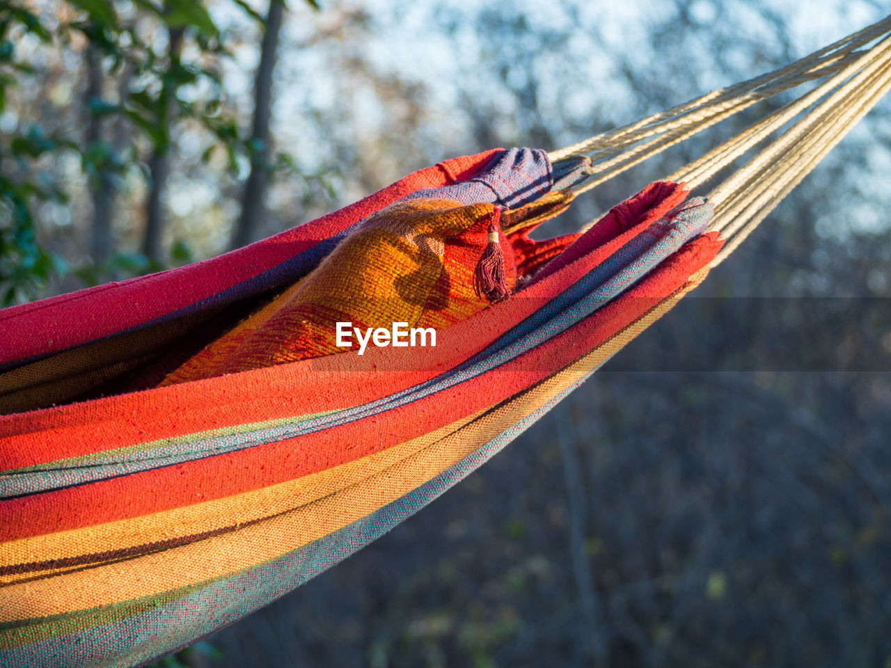 Close-Up Of Colorful Hammock Hanging In Forest