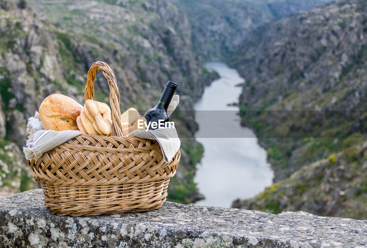 Close-Up Of Picnic Basket Against Mountains