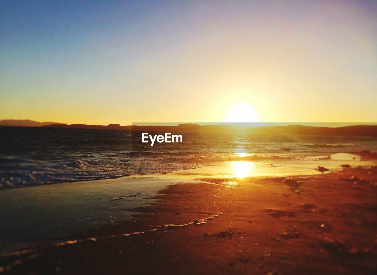 sunset, sea, sun, nature, beach, beauty in nature, sunlight, scenics, water, no people, tranquility, outdoors, wave, sky, clear sky