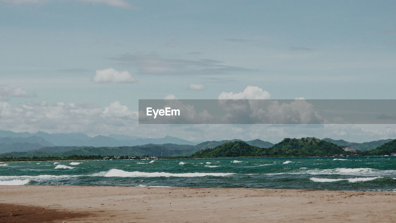 water, sky, beach, sea, land, beauty in nature, cloud - sky, scenics - nature, tranquility, tranquil scene, nature, no people, outdoors, day, sand, mountain, idyllic, motion, non-urban scene
