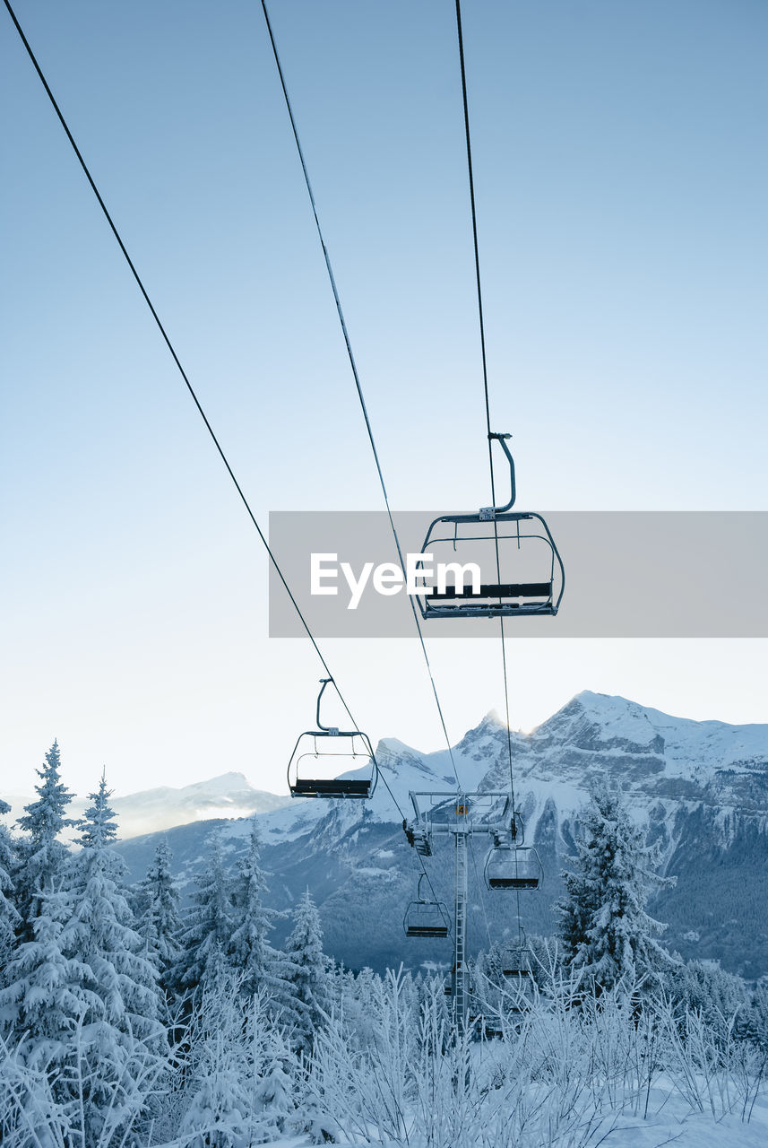 cold temperature, snow, winter, scenics - nature, ski lift, beauty in nature, mountain, nature, cable car, tranquility, sky, tranquil scene, no people, cable, non-urban scene, overhead cable car, environment, land, day, outdoors, snowcapped mountain