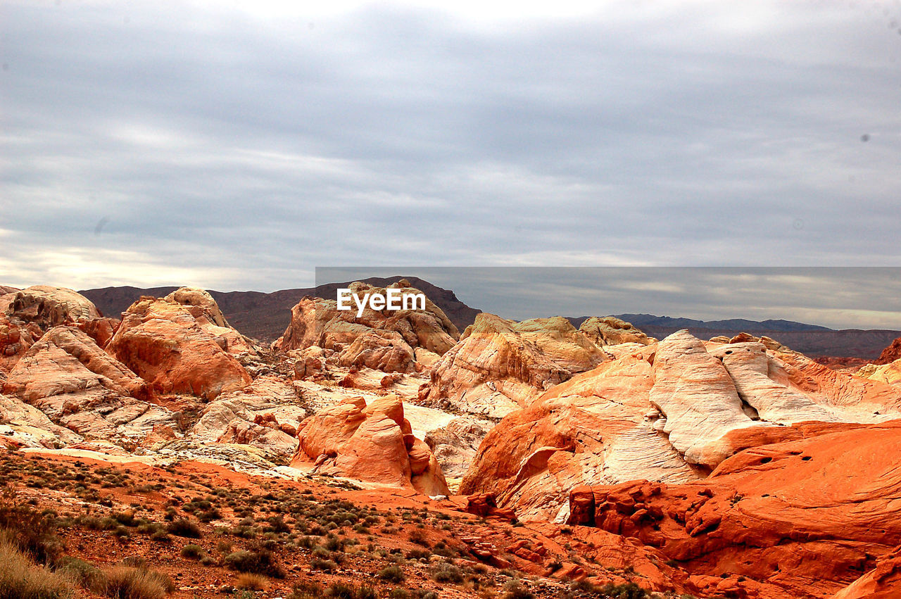 Rock Formations At Red Rock Canyon National Conservation Area Against Cloudy Sky