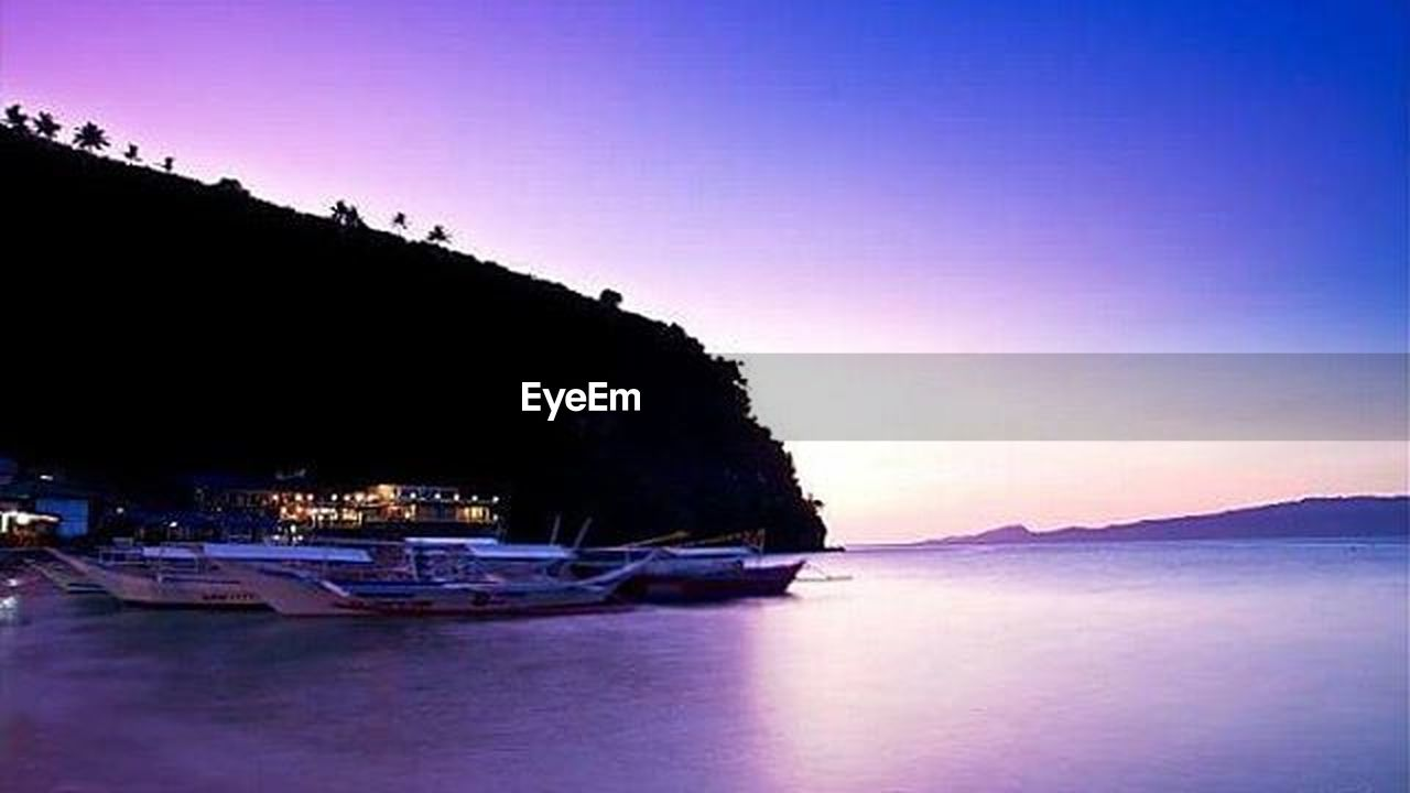 sea, nautical vessel, no people, nature, water, tranquility, outdoors, scenics, beach, mountain, sunset, beauty in nature, night, sky