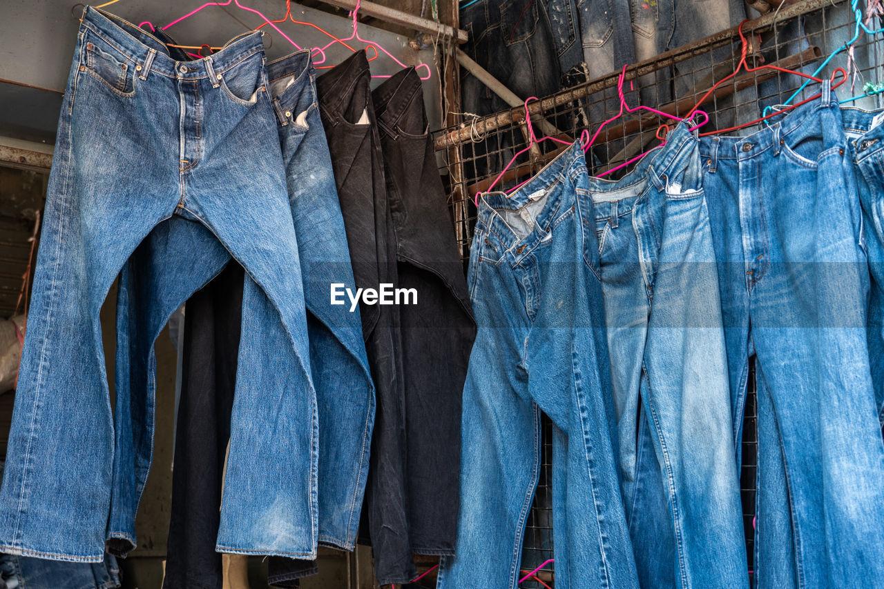 Jeans hanging for sale at market