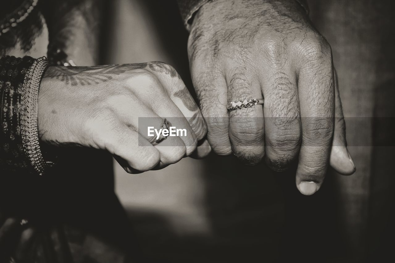 hand, human hand, human body part, jewelry, two people, ring, togetherness, love, bonding, positive emotion, real people, men, adult, body part, women, holding hands, couple - relationship, emotion, finger, people, care