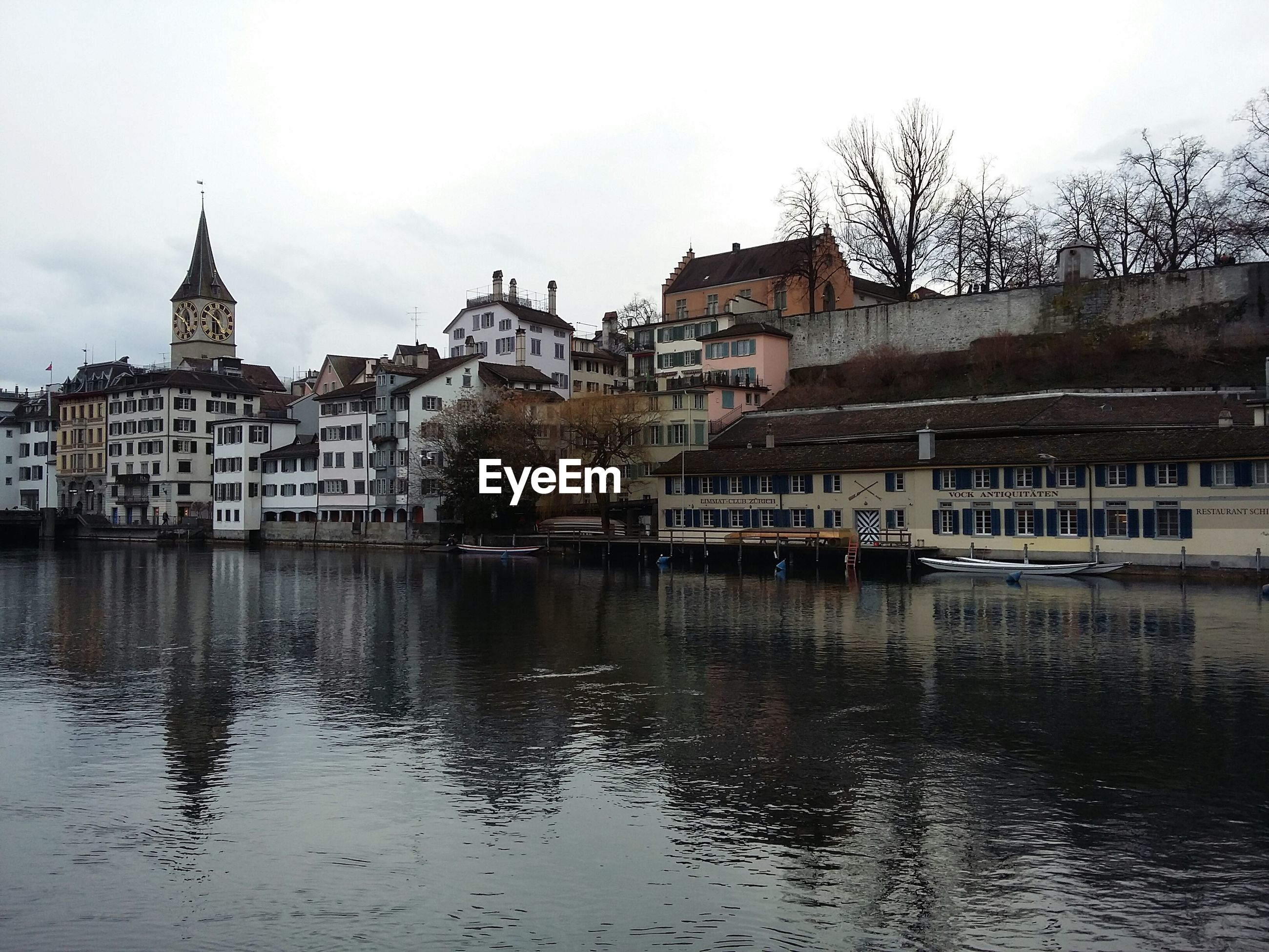 VIEW OF RIVER WITH BUILDINGS IN BACKGROUND
