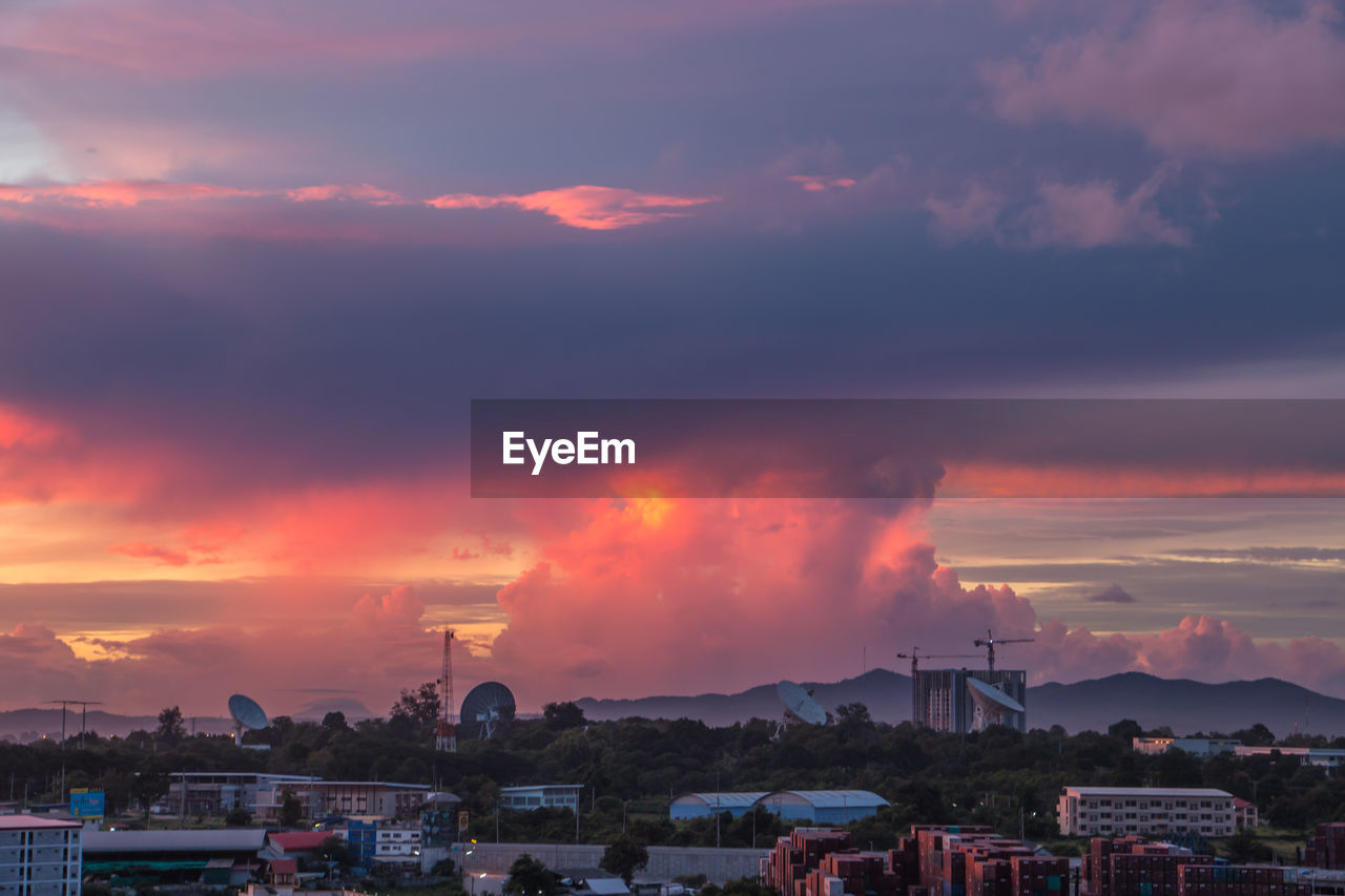 sky, cloud - sky, building exterior, sunset, architecture, built structure, city, building, nature, no people, beauty in nature, residential district, orange color, outdoors, environment, scenics - nature, town, house, cityscape, dusk, townscape