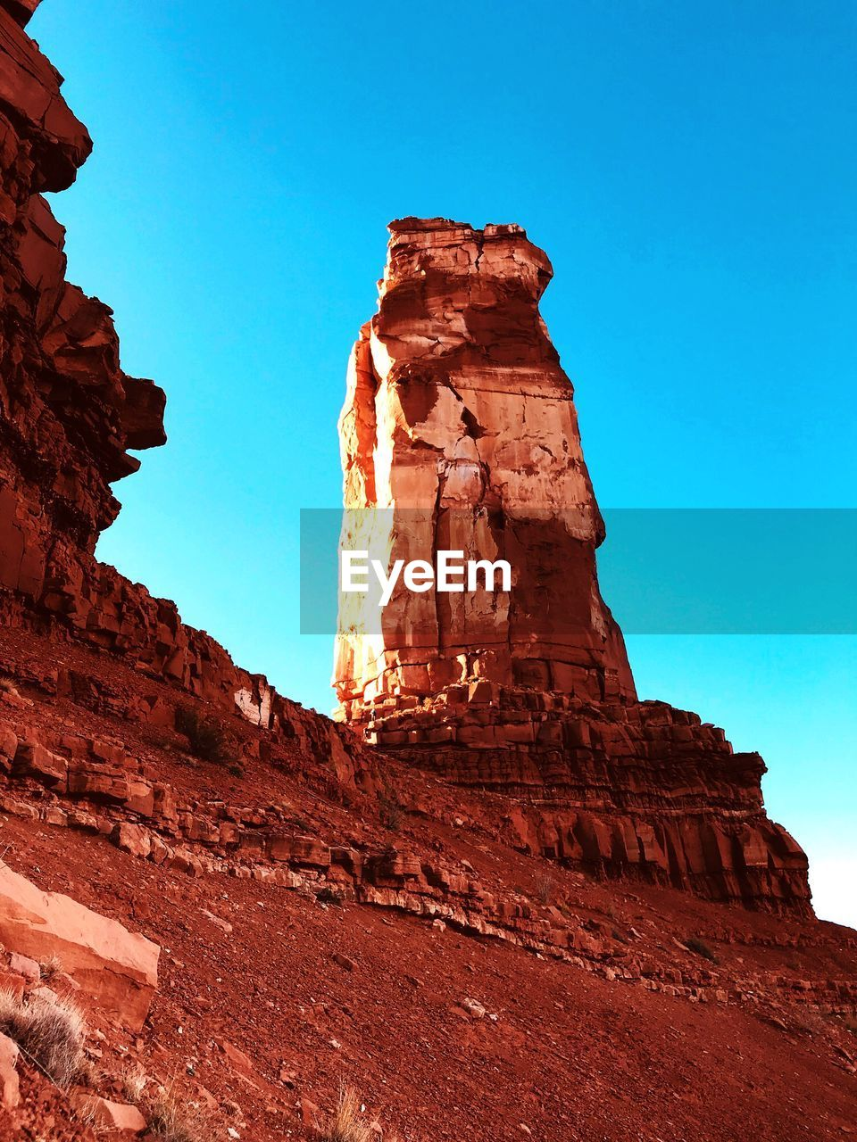 rock formation, geology, rock - object, nature, physical geography, low angle view, travel destinations, tourism, beauty in nature, no people, day, clear sky, outdoors, red, sky