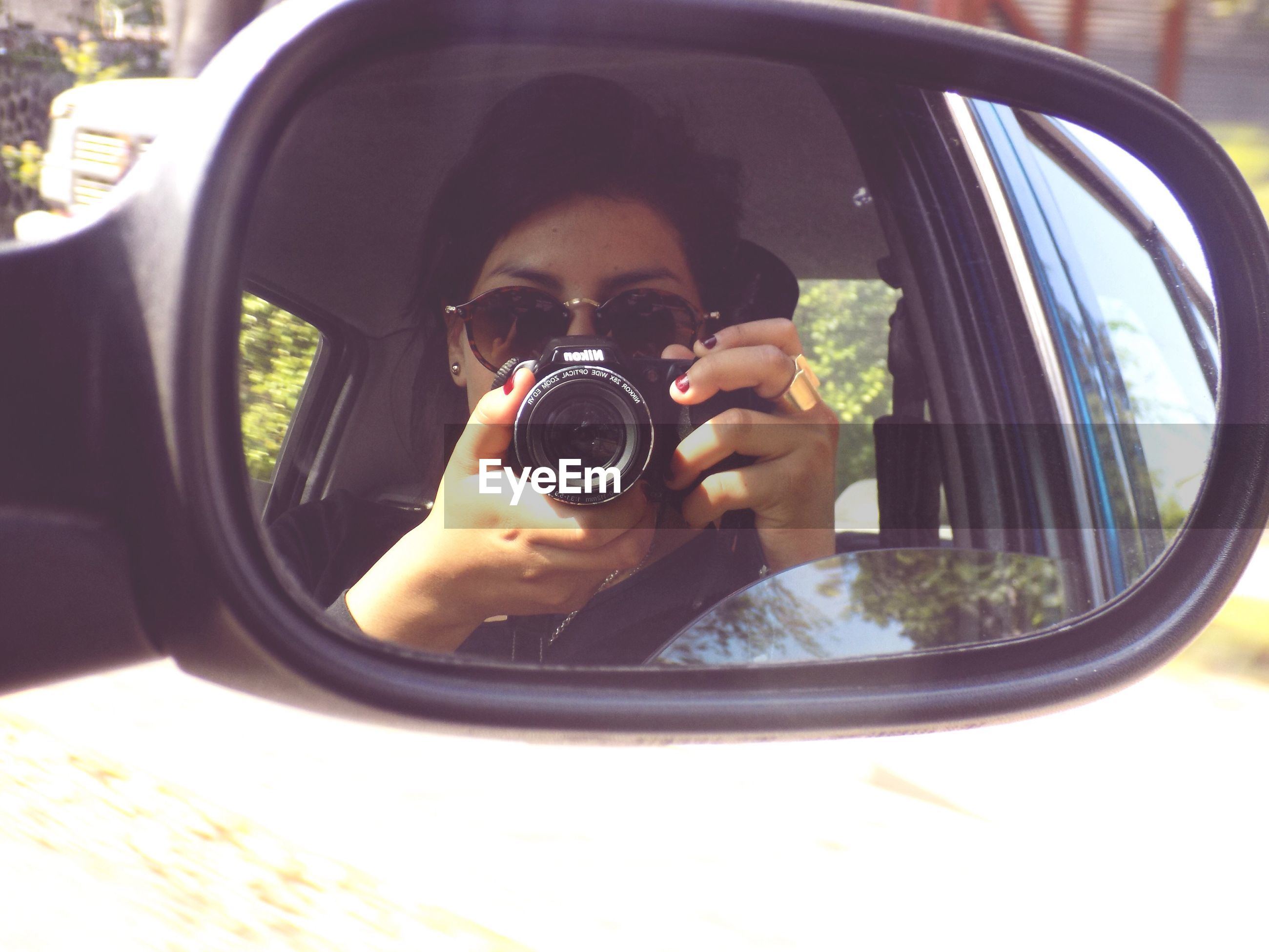 land vehicle, car, transportation, mode of transport, side-view mirror, reflection, sunglasses, vehicle interior, car interior, holding, person, part of, glass - material, close-up, cropped, lifestyles, leisure activity, transparent