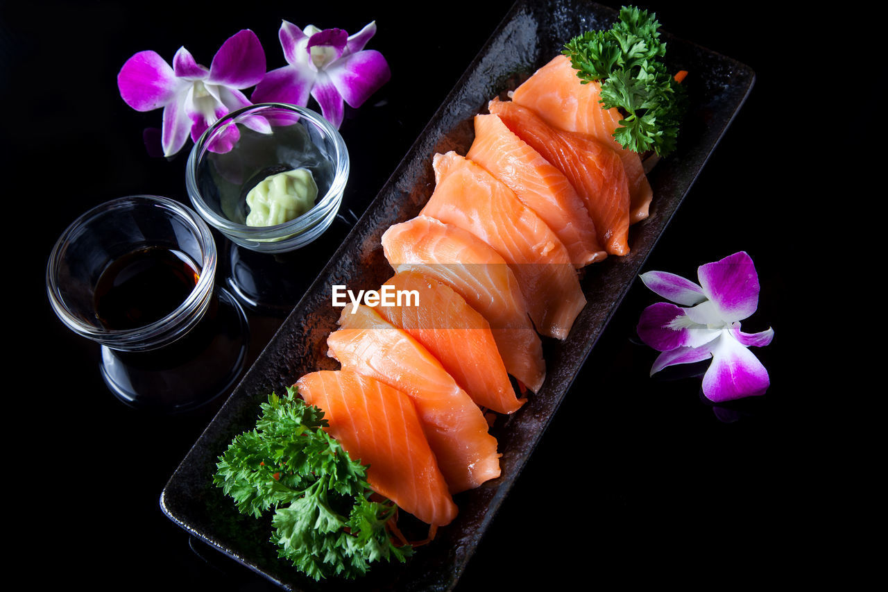freshness, seafood, fish, food and drink, indoors, japanese food, food, asian food, no people, salmon - seafood, studio shot, black background, flowering plant, still life, high angle view, flower, plant, vertebrate, close-up, sashimi, tray