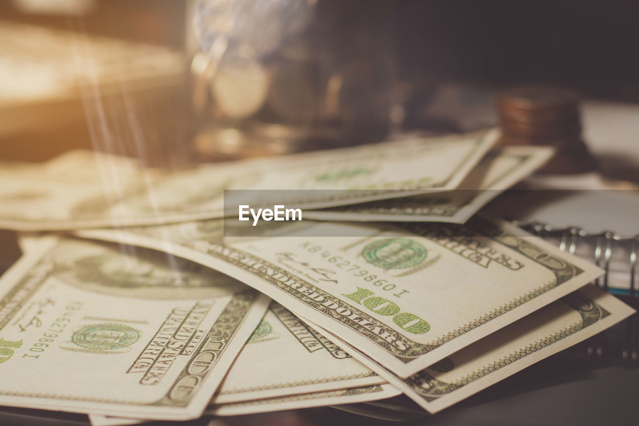 currency, finance, paper currency, business, wealth, indoors, no people, selective focus, close-up, still life, table, savings, investment, text, high angle view, communication, focus on foreground, economy