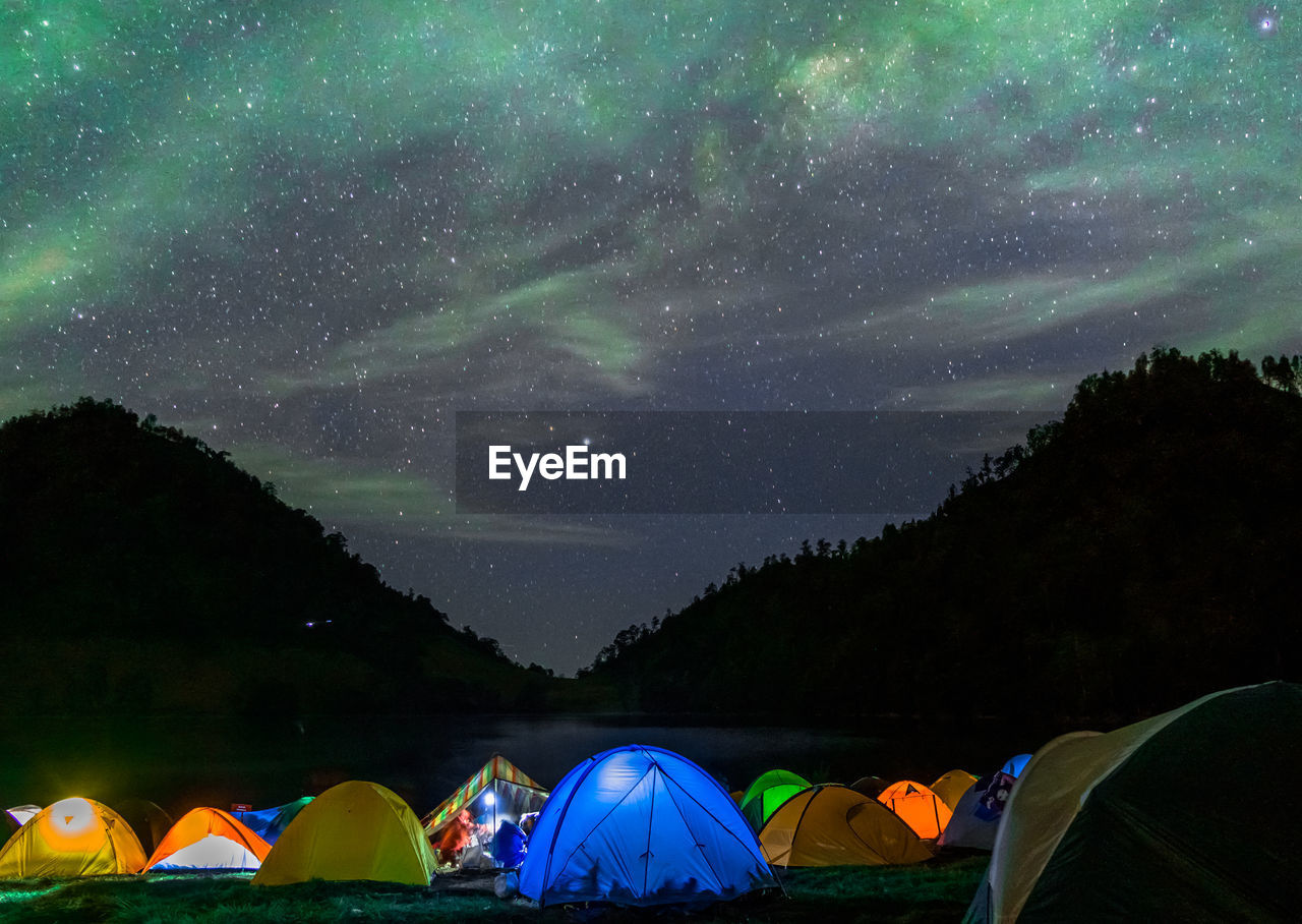 Scenic View Of Tents Against Sky At Night