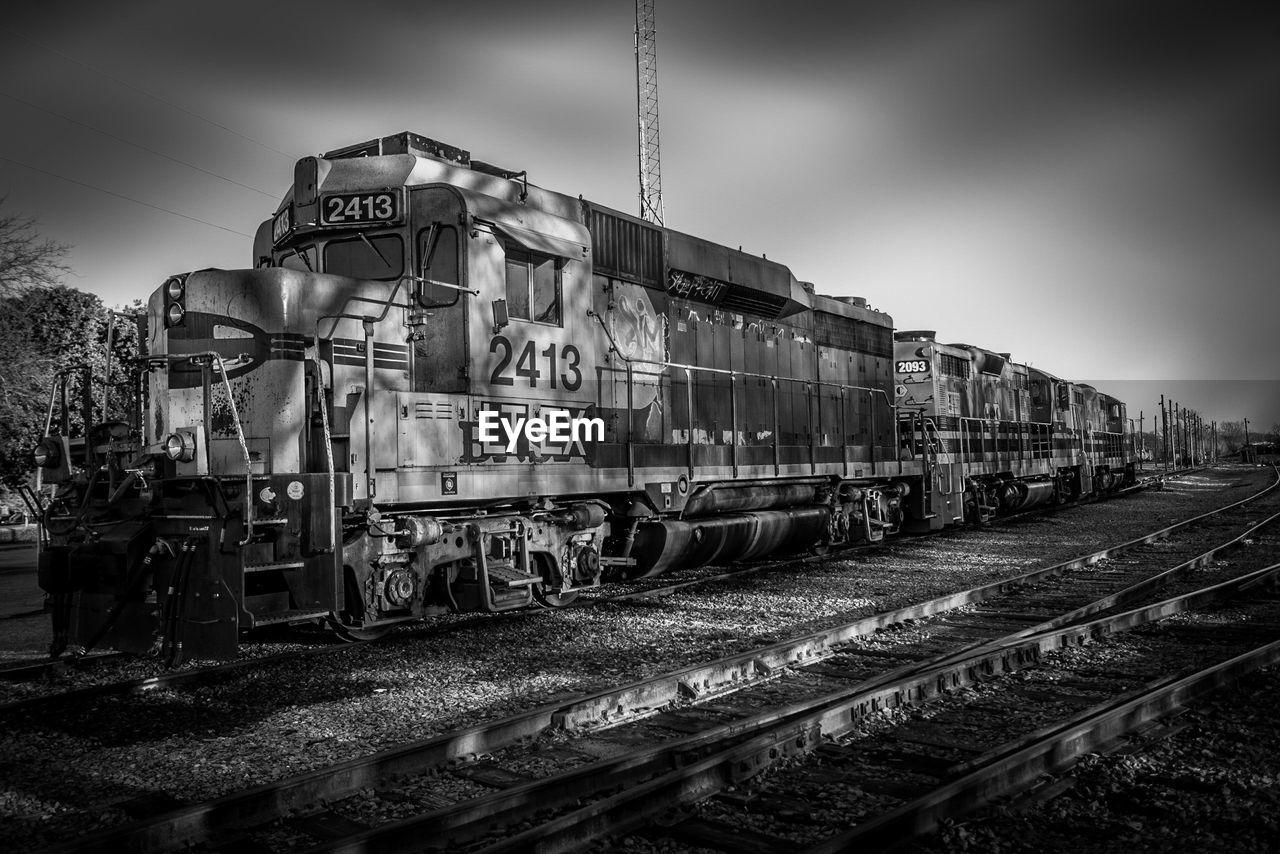railroad track, transportation, rail transportation, train - vehicle, mode of transport, outdoors, public transportation, day, sky, locomotive, no people, steam train