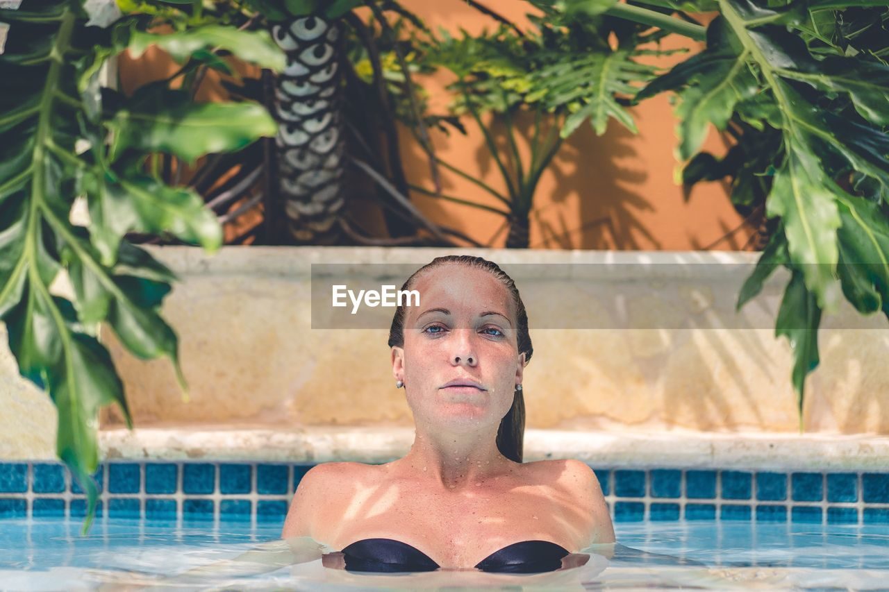 Close-Up Of Woman In Swimming Pool