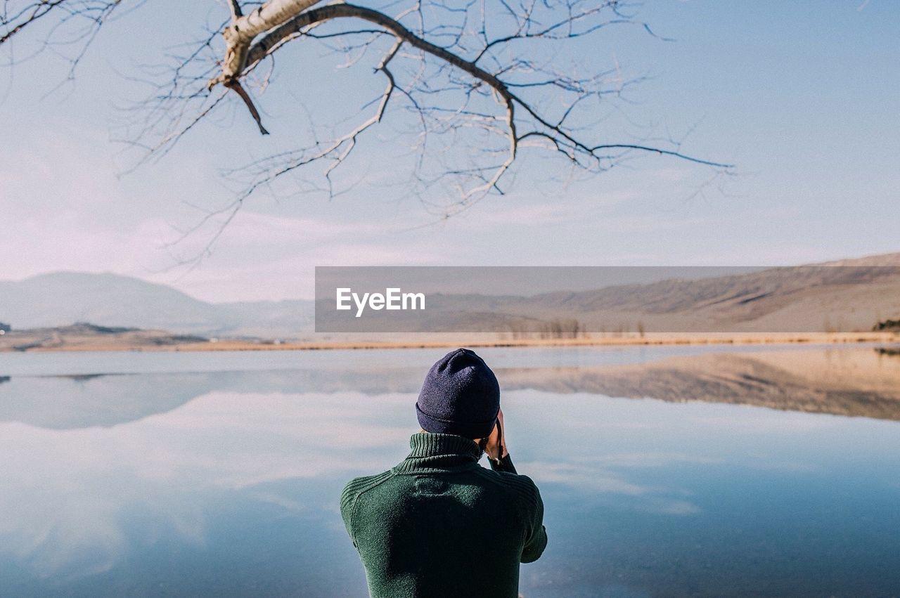 Rear View Of Man In Lake