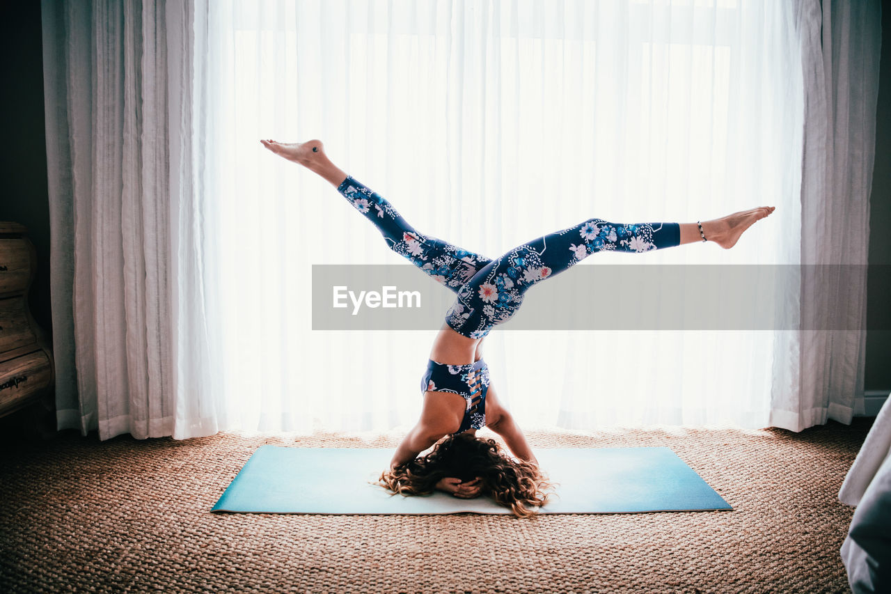 Upside Down Image Of Woman Exercising At Home