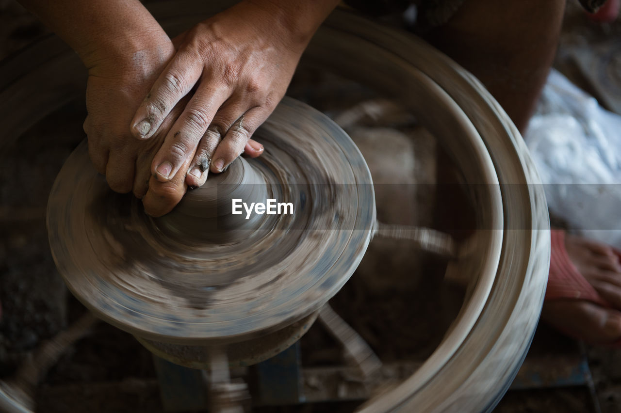 Cropped Image Of Craftsperson Working On Pottery Wheel