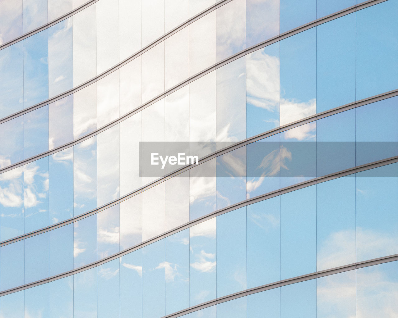 Full Frame Shot Of Glass Building With Reflection