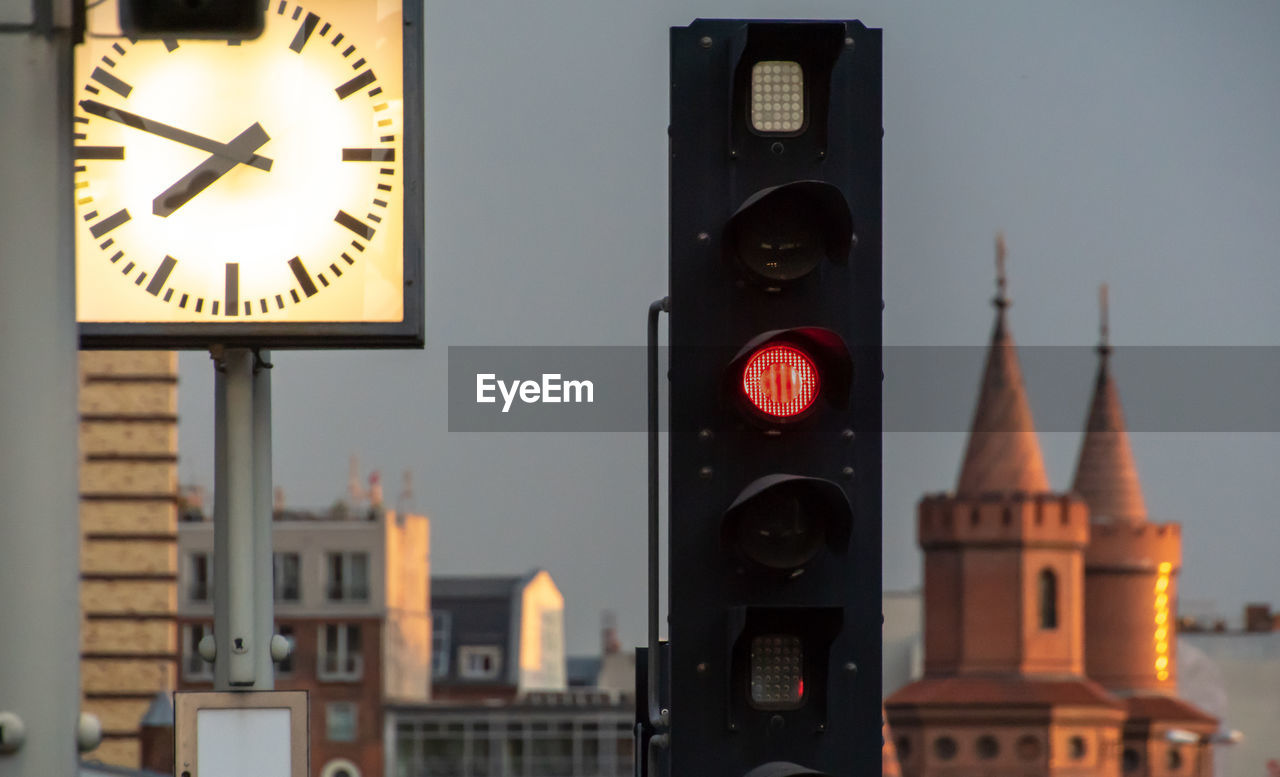 Low Angle View Of Stoplight Against Buildings In City