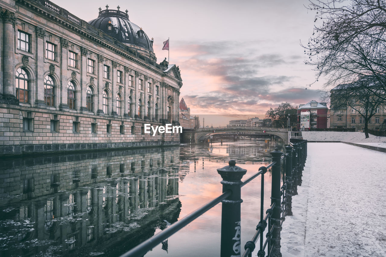 Spree River By Bode Museum Against Sky During Winter