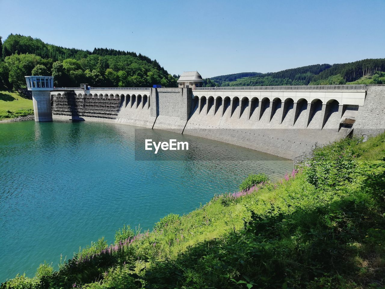 water, plant, sky, architecture, hydroelectric power, nature, dam, tree, built structure, renewable energy, day, fuel and power generation, beauty in nature, environmental conservation, no people, scenics - nature, outdoors, green color, growth, bridge - man made structure, flowing water, arch bridge
