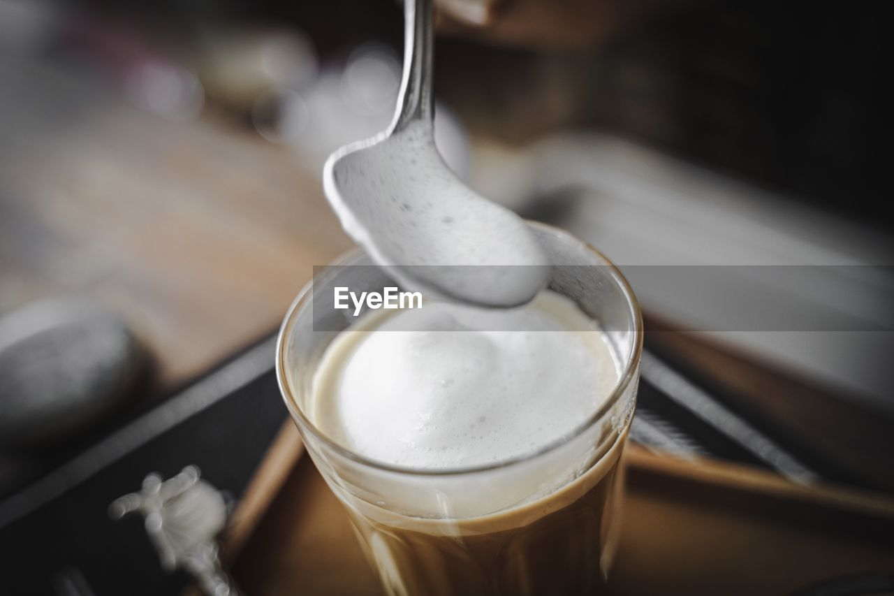 food and drink, refreshment, drink, close-up, still life, focus on foreground, frothy drink, household equipment, no people, coffee, indoors, coffee - drink, freshness, table, glass, food, drinking glass, kitchen utensil, eating utensil, spoon, froth, latte