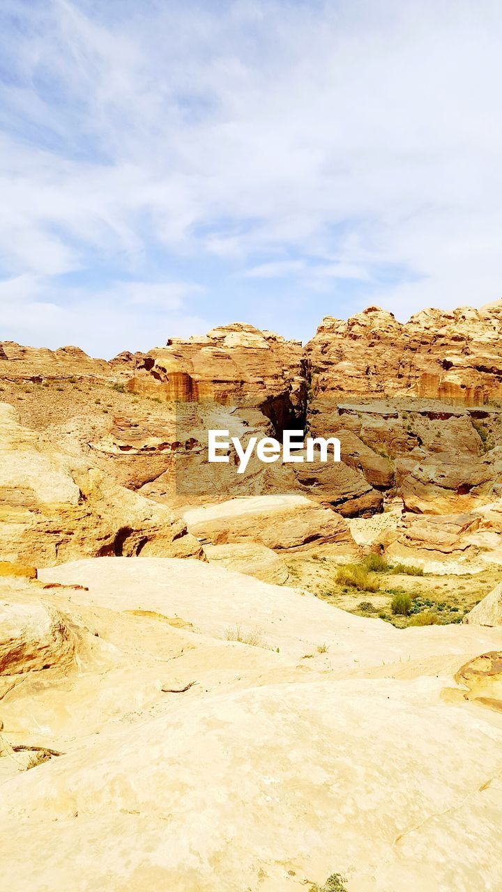 sky, tranquil scene, non-urban scene, scenics - nature, tranquility, cloud - sky, landscape, beauty in nature, rock formation, rock, rock - object, environment, day, no people, remote, solid, desert, nature, climate, physical geography, arid climate, outdoors, eroded