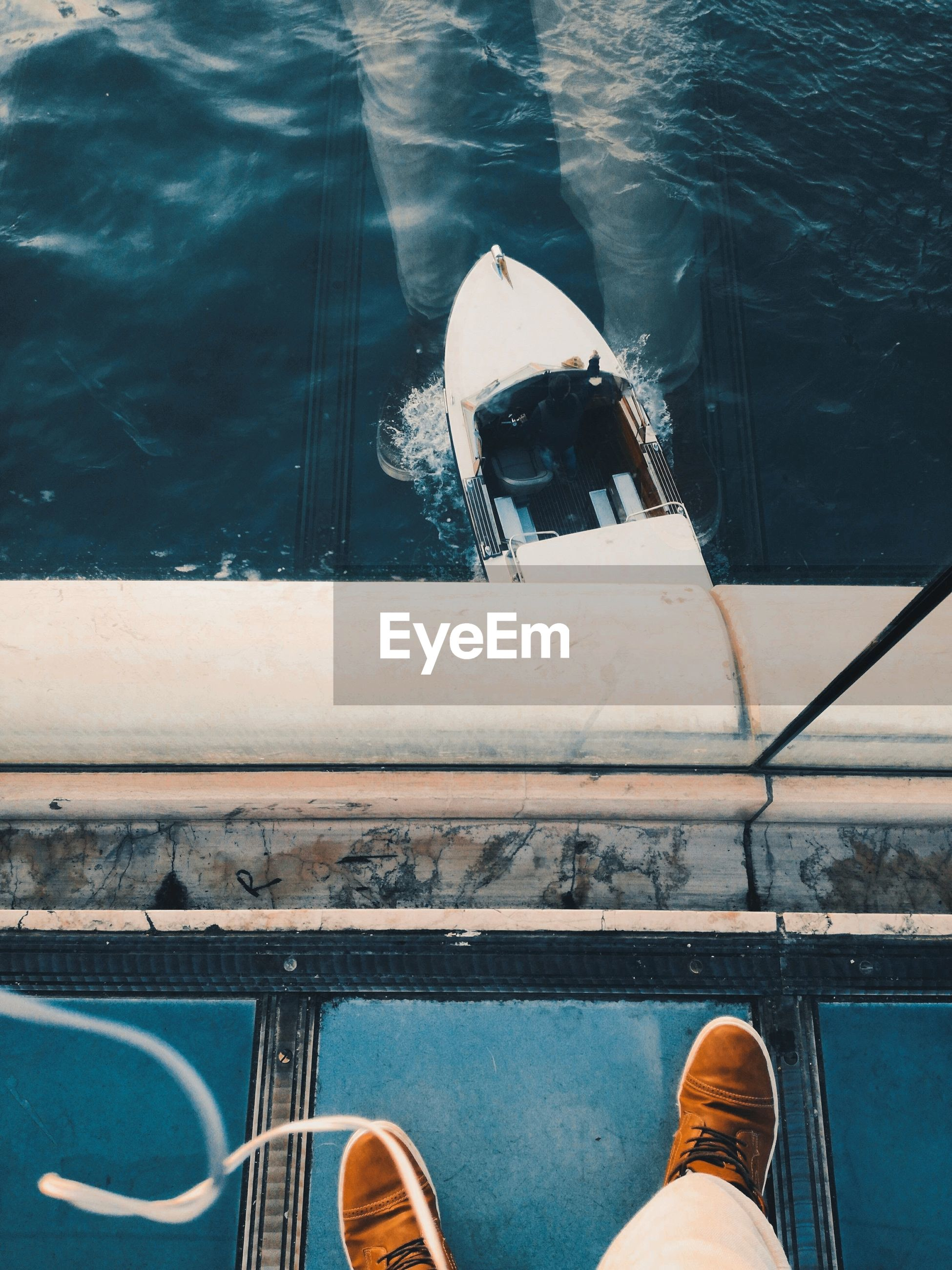 Low section of man on boat in sea