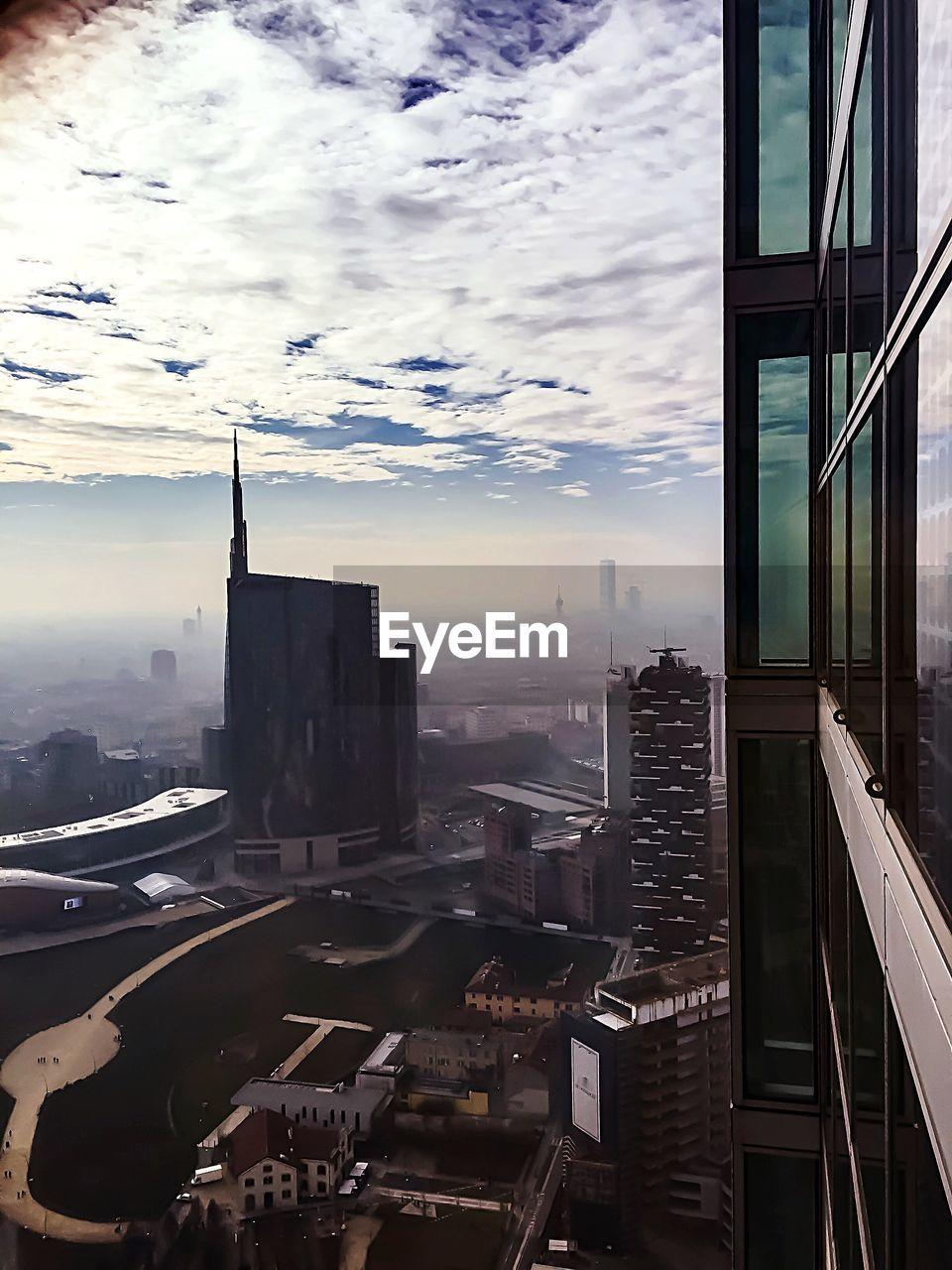 architecture, building exterior, built structure, city, skyscraper, sky, cityscape, no people, cloud - sky, travel destinations, outdoors, modern, day, urban skyline