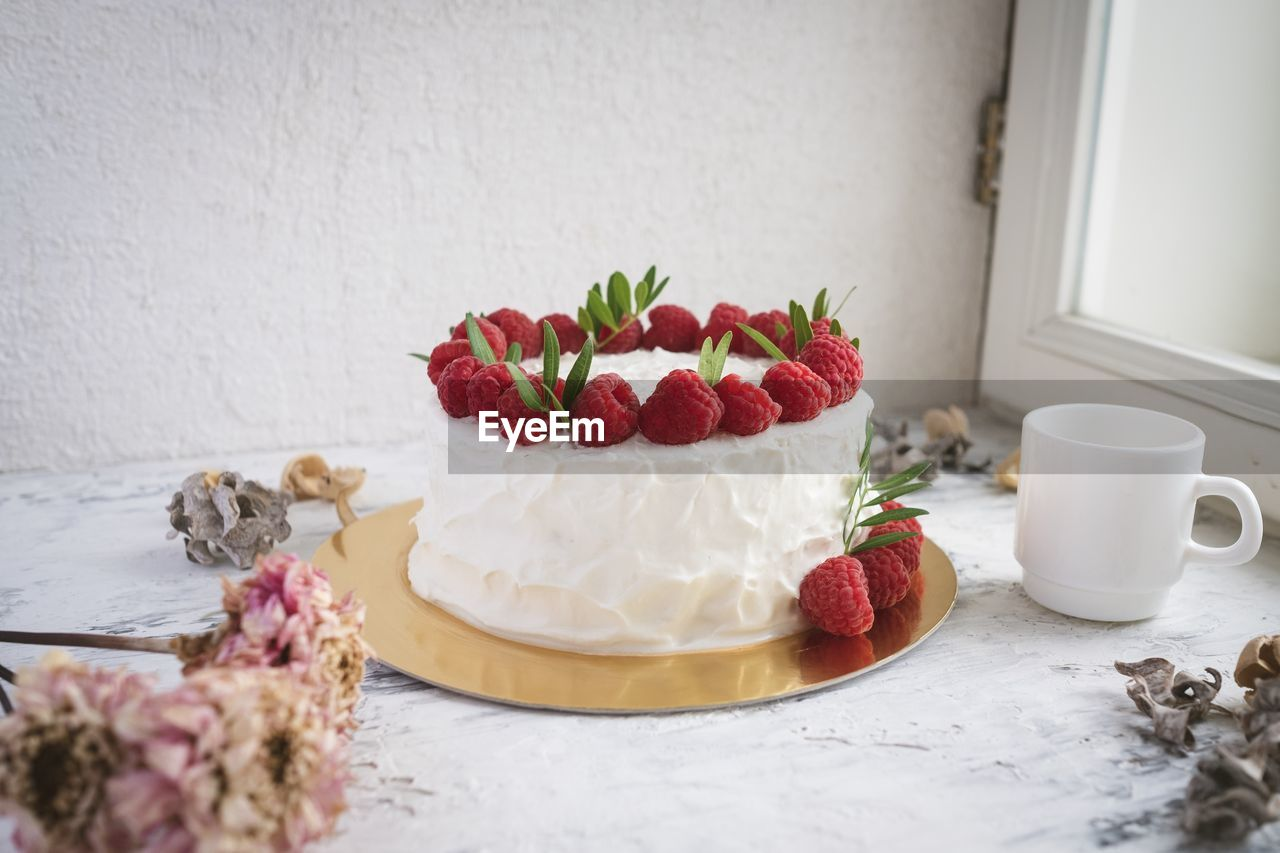 food and drink, freshness, table, sweet food, sweet, dessert, food, cake, cup, still life, berry fruit, indoors, fruit, indulgence, baked, temptation, strawberry, no people, plant, flowering plant, crockery