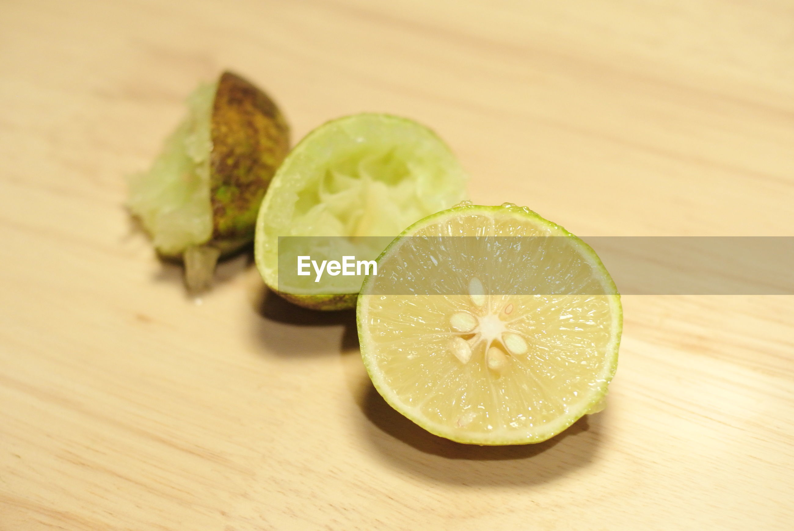 Close-up of halved lemon on wooden table