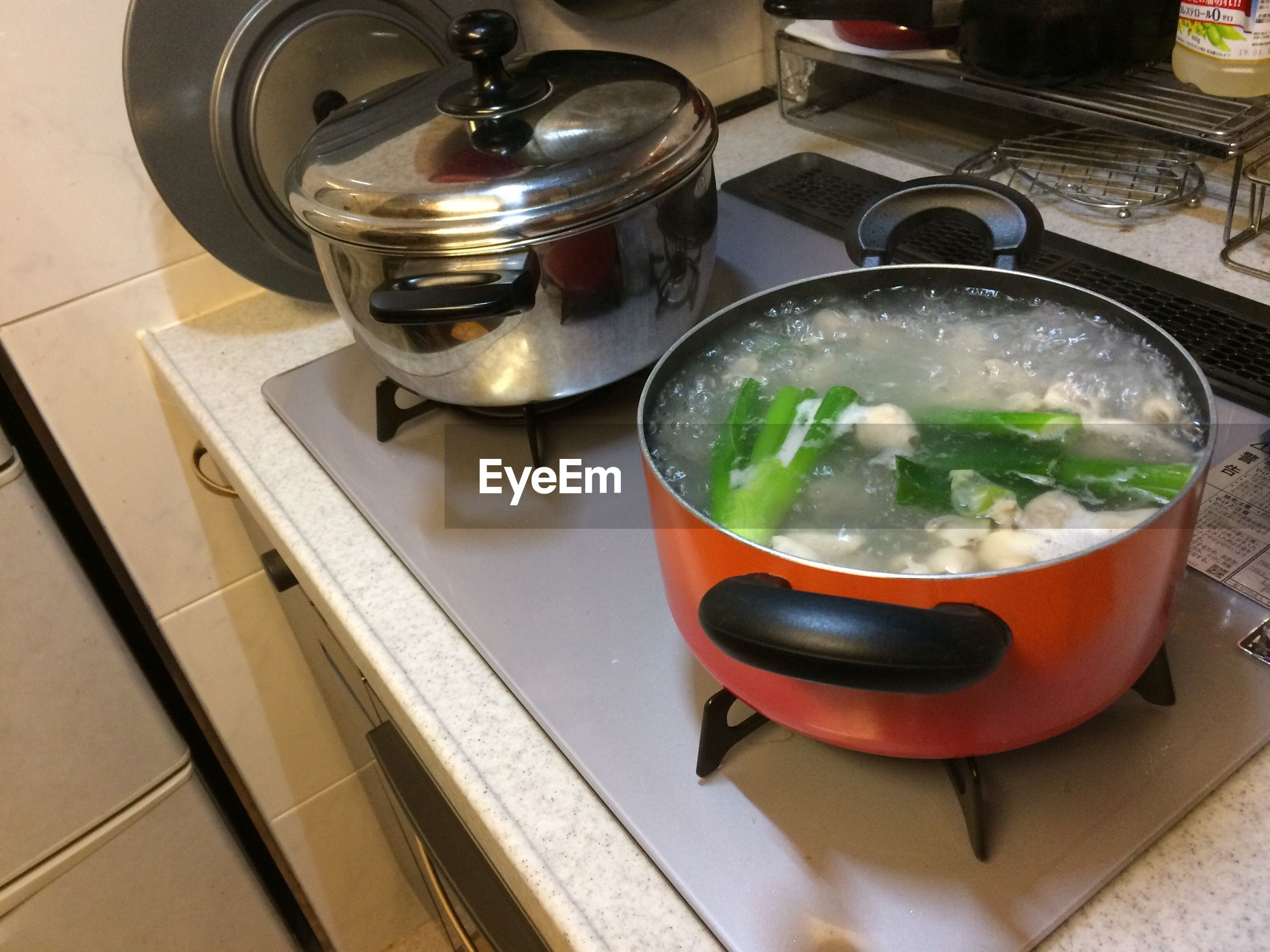 food and drink, food, indoors, domestic kitchen, appliance, healthy eating, no people, stove, bowl, high angle view, kitchen, soup, freshness, preparation, vegetable, domestic room, close-up, ready-to-eat, day