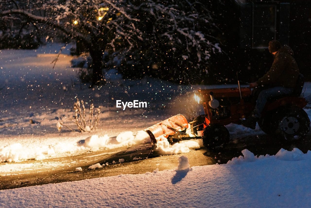 VIEW OF PEOPLE ON SNOW DURING NIGHT