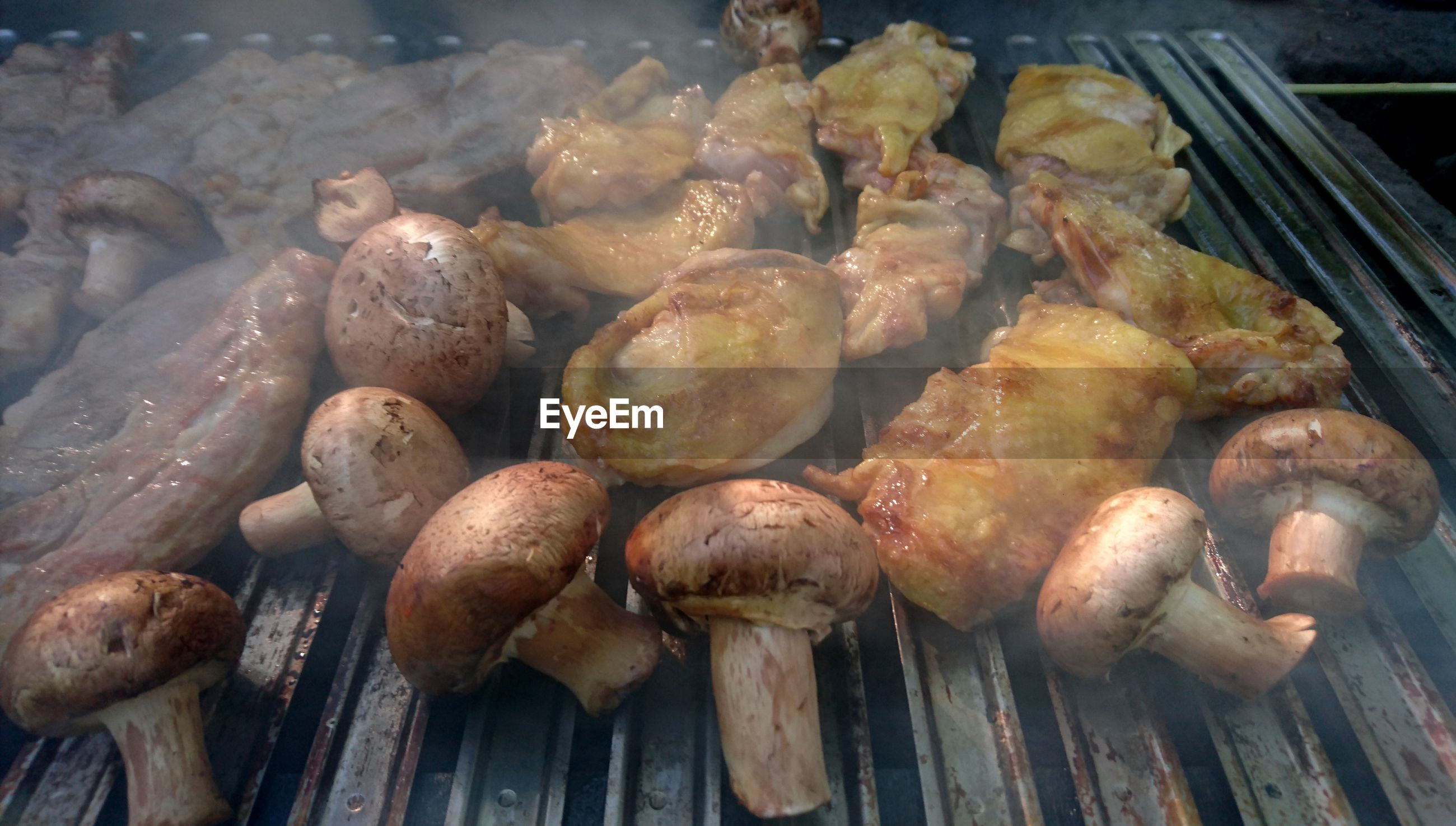 CLOSE-UP OF ROASTED MEAT ON BARBECUE