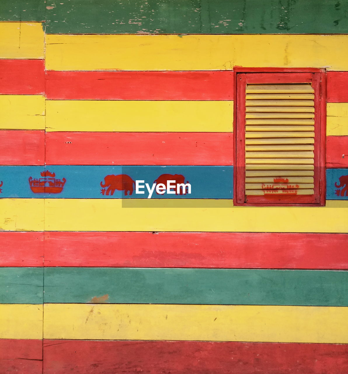 yellow, multi colored, architecture, built structure, red, full frame, backgrounds, pattern, no people, building exterior, day, wall - building feature, vibrant color, closed, outdoors, paint, striped, painted, blue, metal, purple