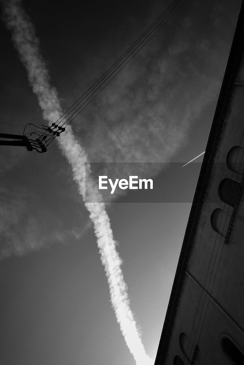 Low angle view of contrail at sky