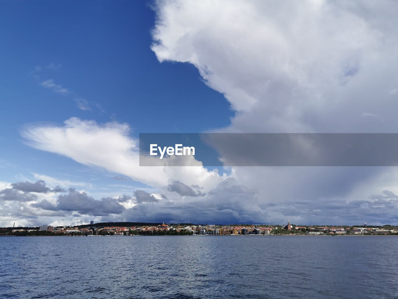 cloud - sky, sky, water, beauty in nature, scenics - nature, architecture, sea, tranquil scene, nature, tranquility, waterfront, day, built structure, no people, building exterior, outdoors, idyllic, non-urban scene, blue