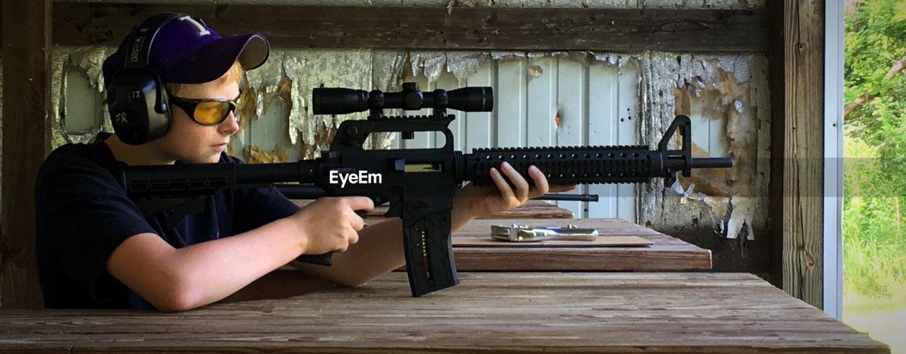 Man Practicing With Rifle At Shooting Range