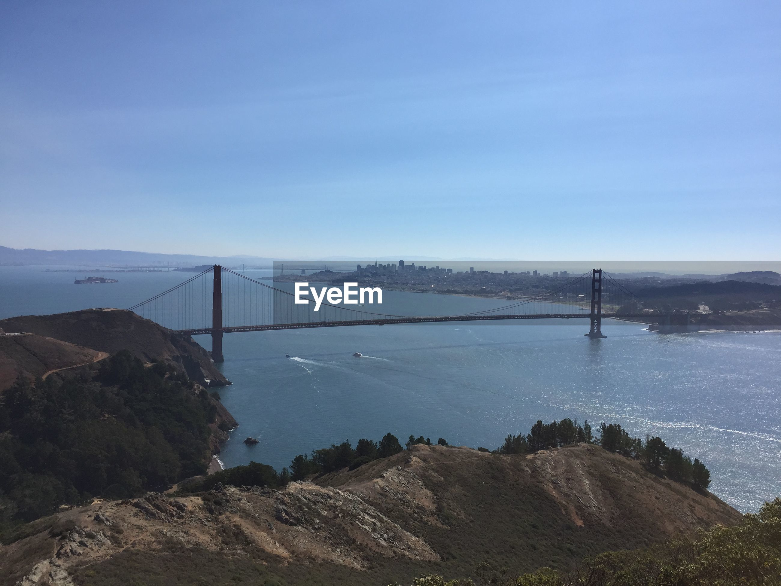 High angle view of golden gate bridge over bay against sky