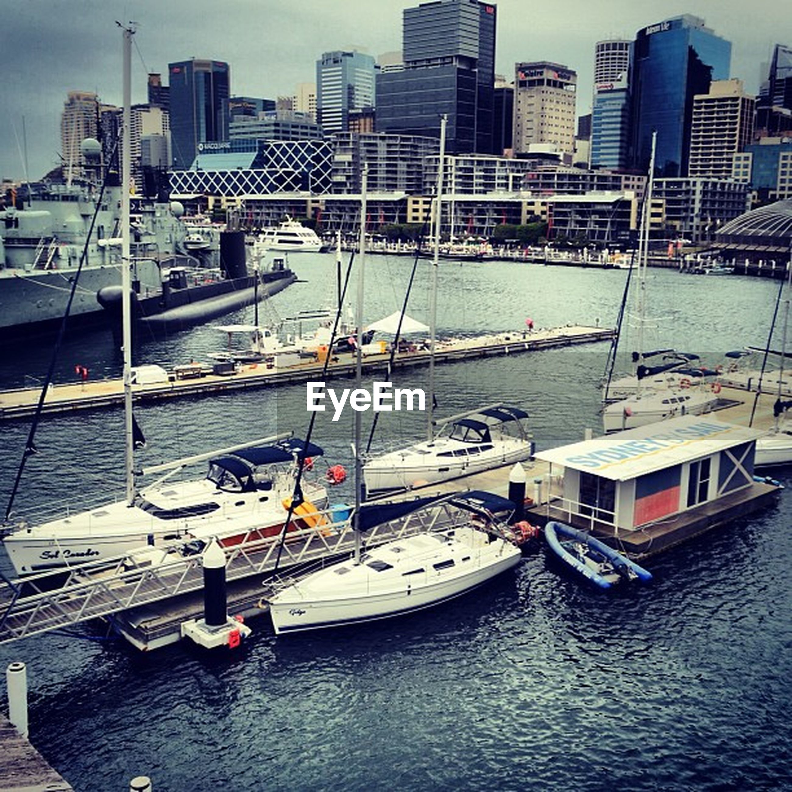 nautical vessel, building exterior, architecture, water, built structure, boat, waterfront, transportation, city, mode of transport, harbor, moored, river, skyscraper, sea, office building, day, sailboat, cityscape, urban skyline