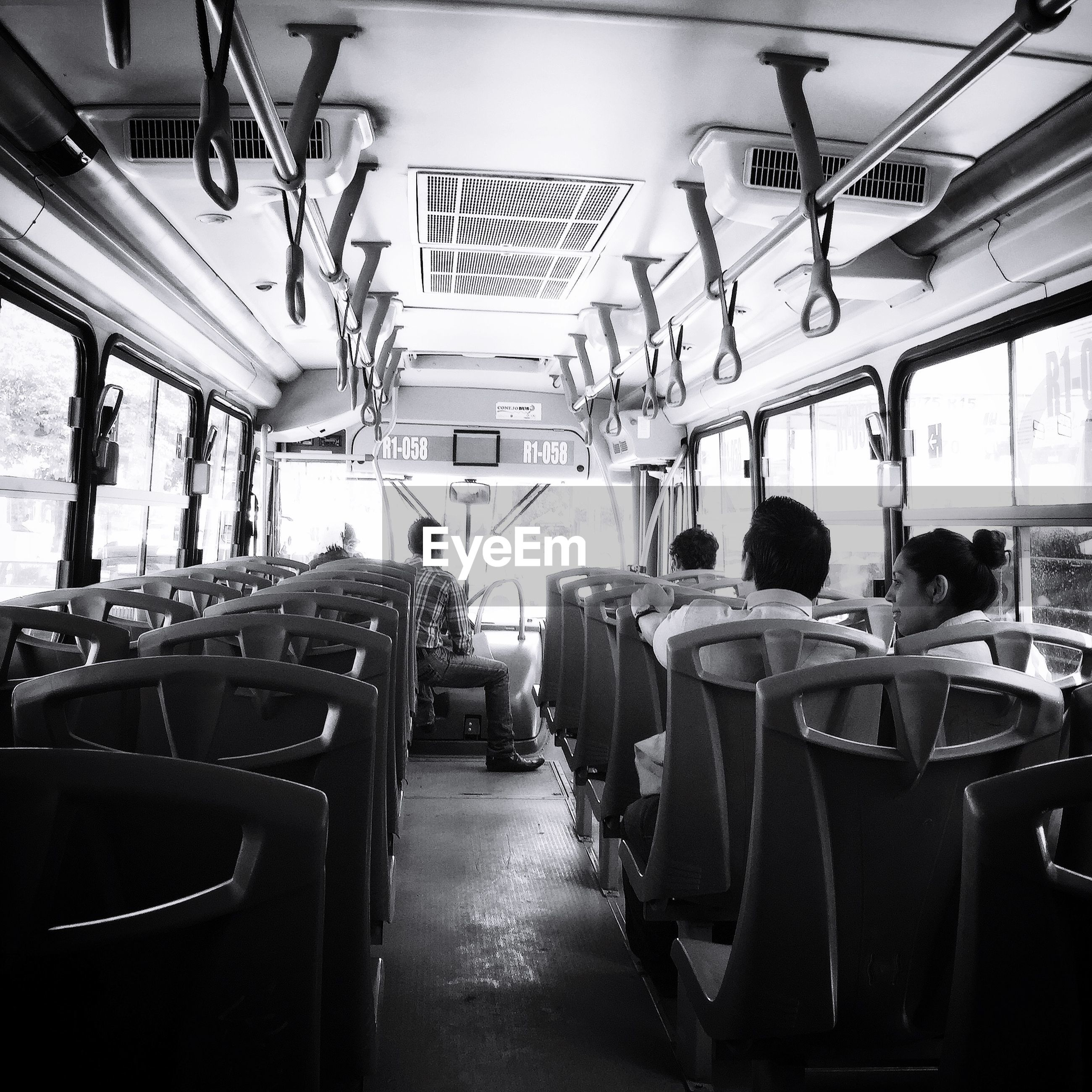 indoors, architecture, built structure, transportation, chair, incidental people, mode of transport, the way forward, empty, table, in a row, diminishing perspective, absence, ceiling, restaurant, lighting equipment, land vehicle, day, narrow, travel