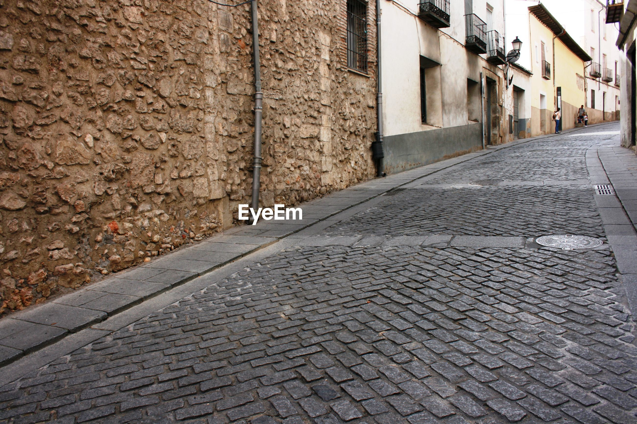 Cobblestone walkway by old houses