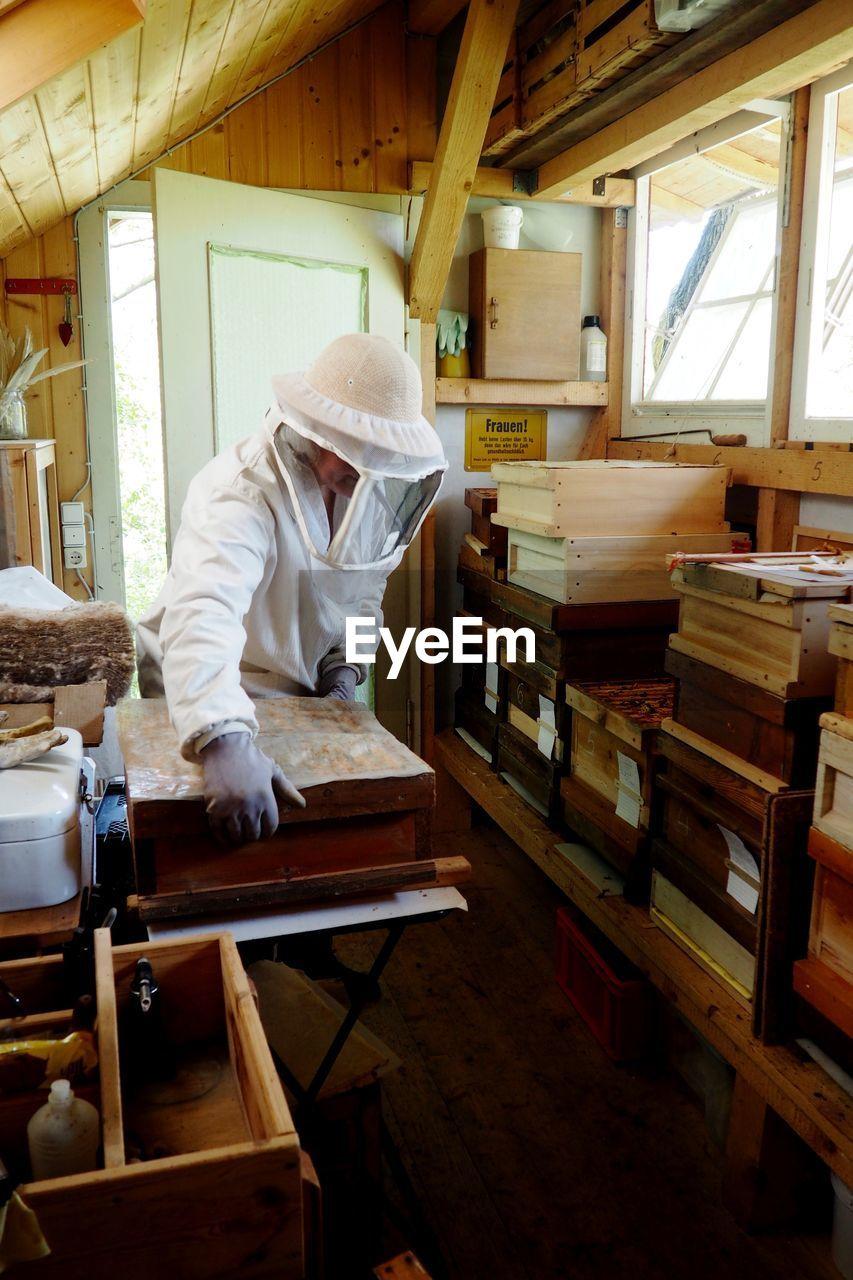 Beekeeper Working In Warehouse