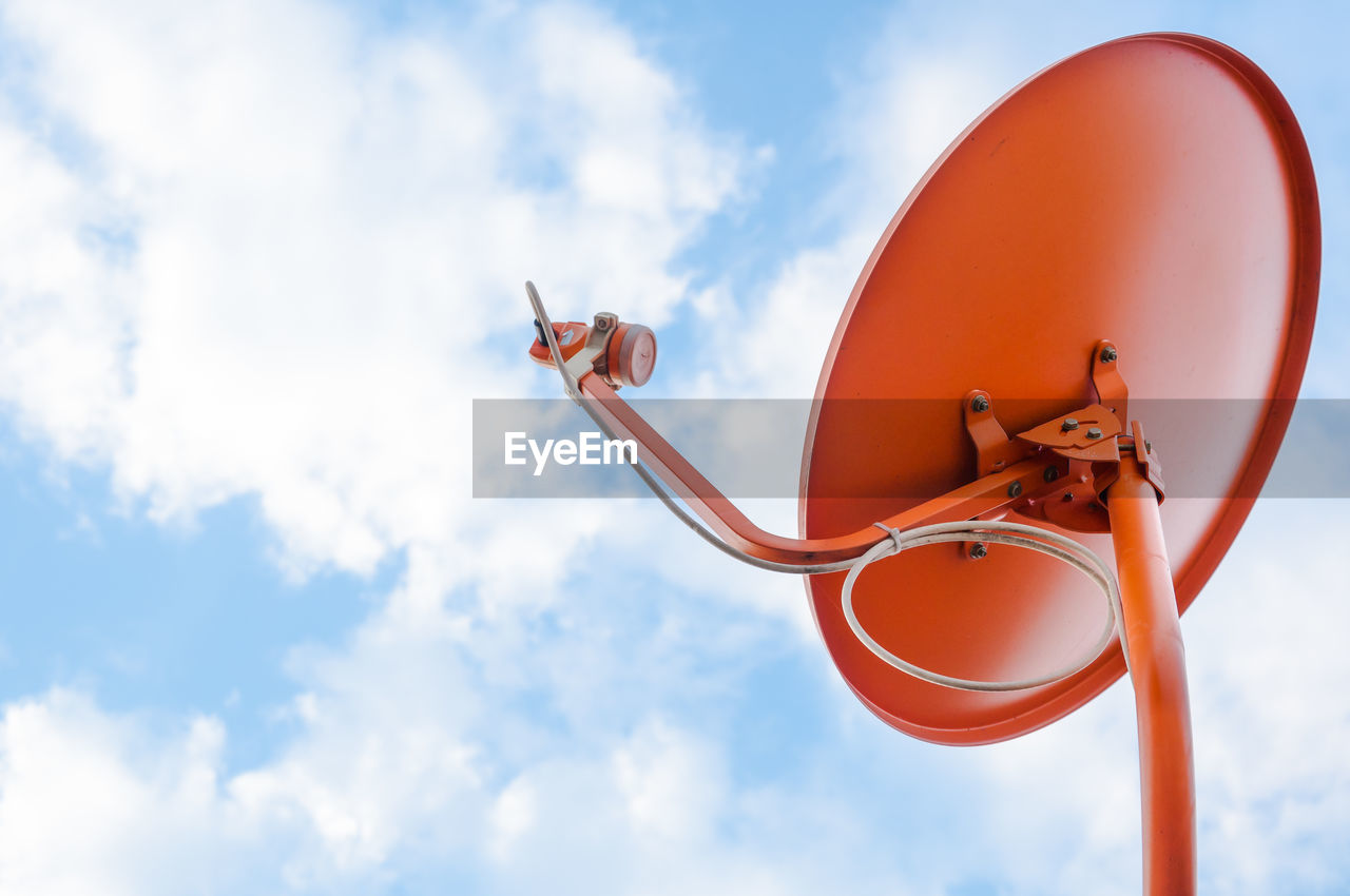 sky, low angle view, cloud - sky, nature, day, technology, no people, communication, orange color, outdoors, focus on foreground, telecommunications equipment, red, metal, shape, megaphone, circle, connection, satellite dish, satellite, global communications