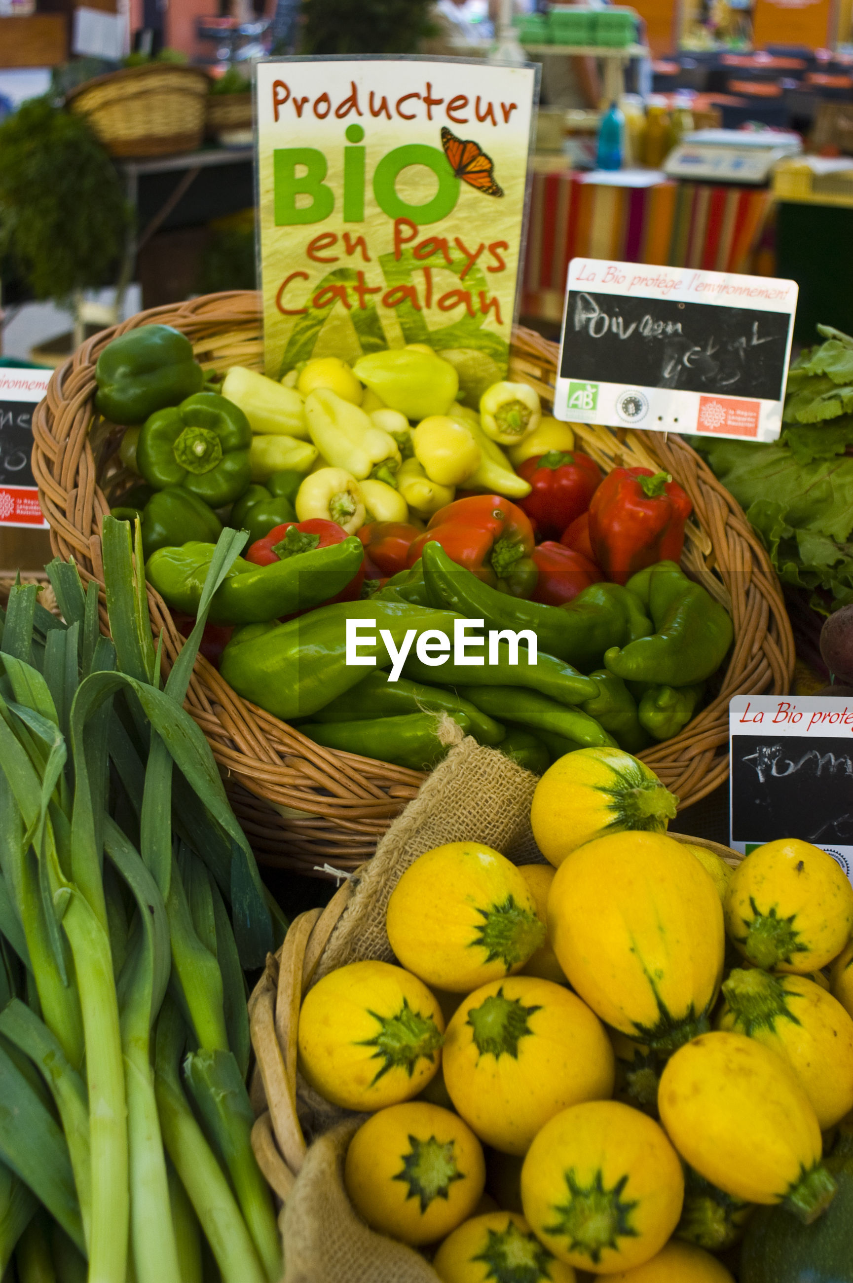 Price tags on vegetables at market stall