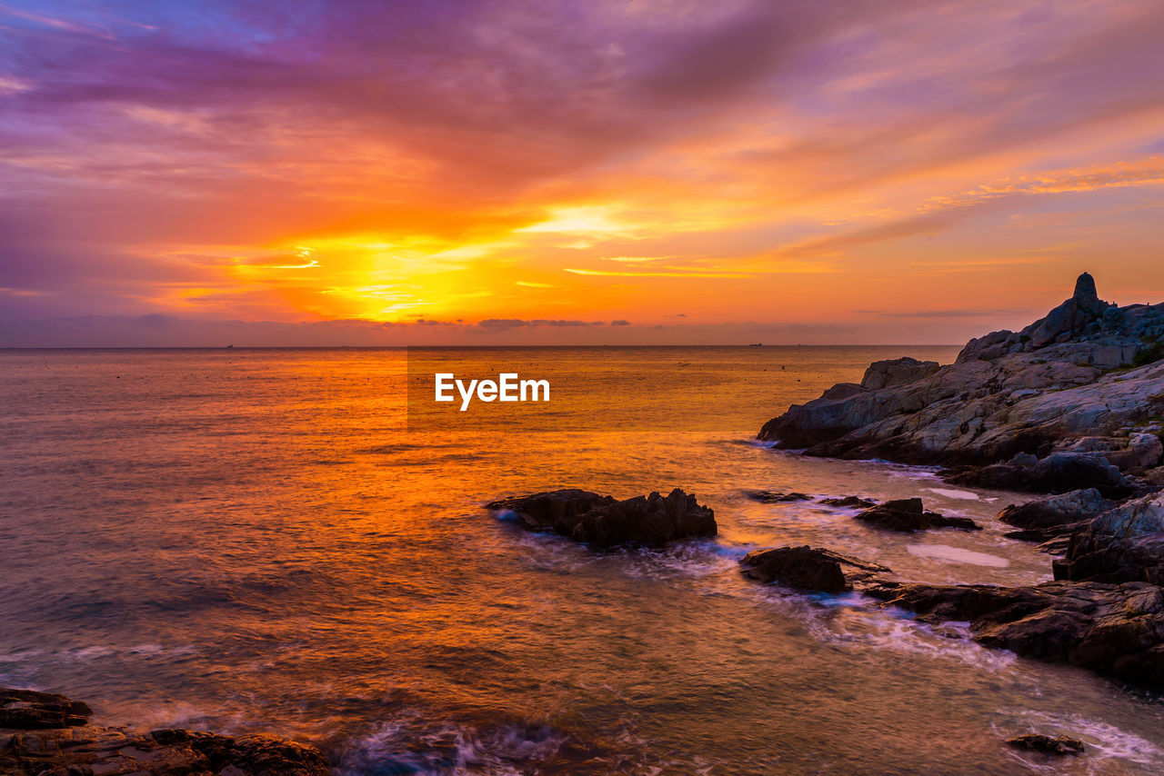 sky, sunset, sea, water, beauty in nature, scenics - nature, orange color, cloud - sky, horizon over water, tranquility, tranquil scene, idyllic, rock, land, horizon, nature, no people, rock - object, beach, outdoors