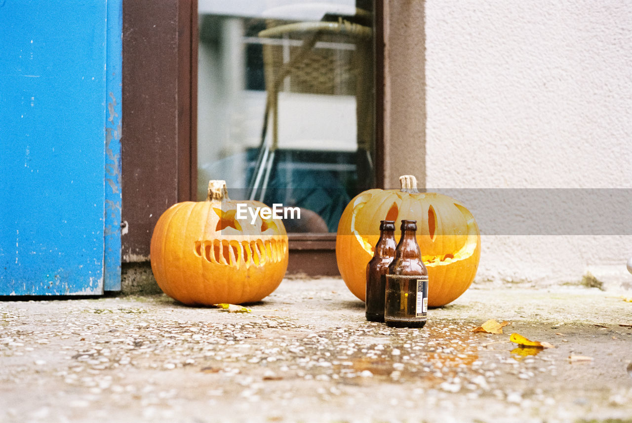 food and drink, food, pumpkin, building exterior, day, halloween, door, celebration, architecture, no people, entrance, built structure, orange color, anthropomorphic face, face, anthropomorphic, citrus fruit, art and craft, fruit, window, outdoors, jack o' lantern, orange