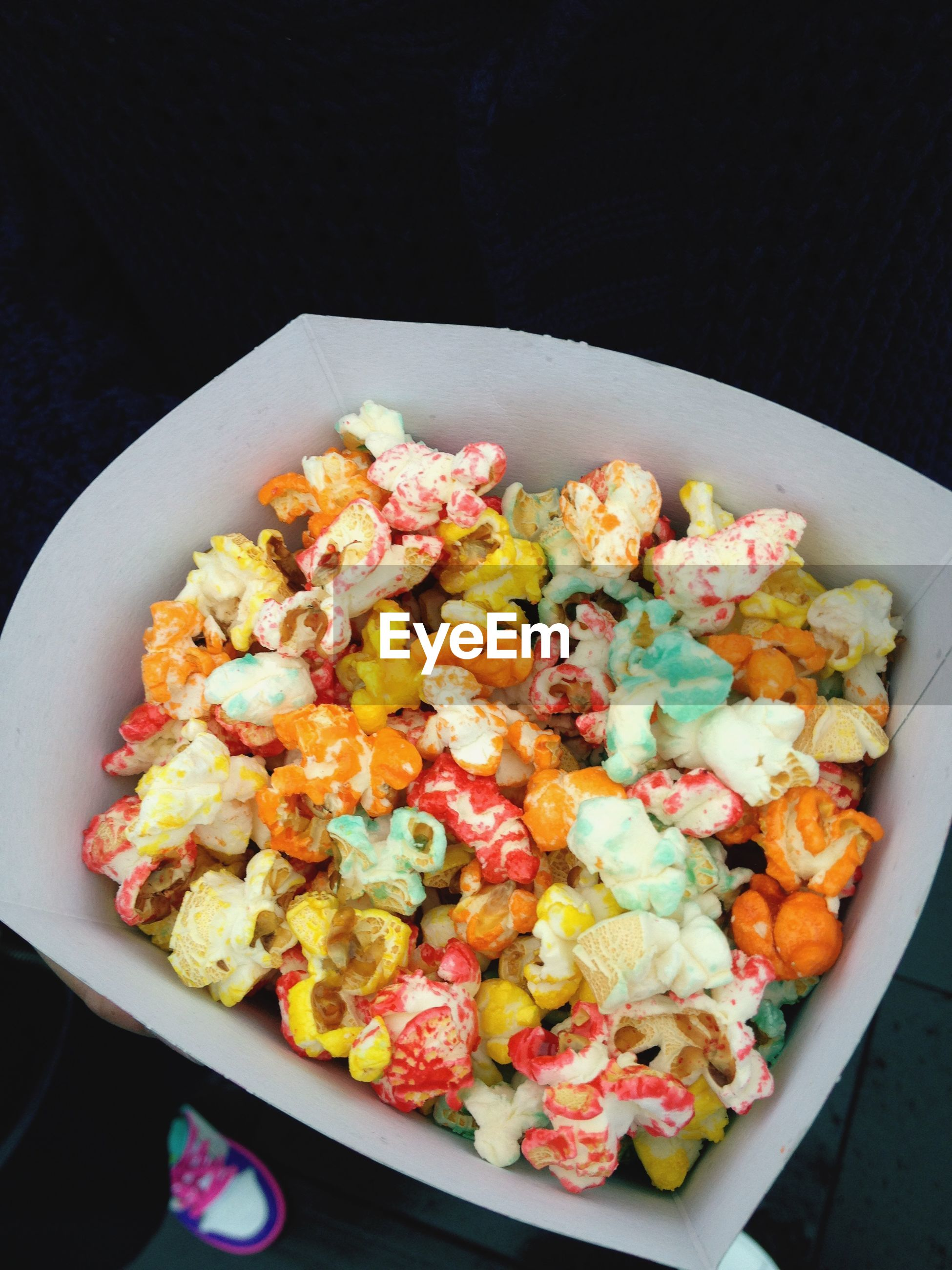 High angle view of colorful popcorns in container