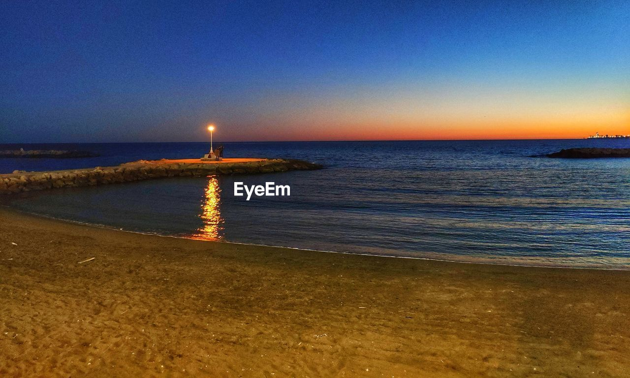 water, sea, sky, beach, land, beauty in nature, horizon, horizon over water, tranquility, scenics - nature, tranquil scene, clear sky, nature, sunset, idyllic, no people, sand, outdoors, non-urban scene