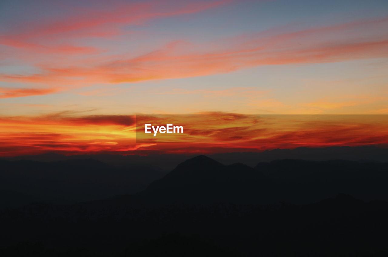 sunset, sky, beauty in nature, scenics - nature, tranquil scene, orange color, mountain, tranquility, silhouette, cloud - sky, idyllic, no people, non-urban scene, nature, mountain range, environment, landscape, dramatic sky, remote, majestic, outdoors, romantic sky, mountain peak